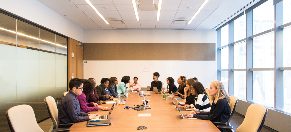Group of stakeholders discussing in a meeting room