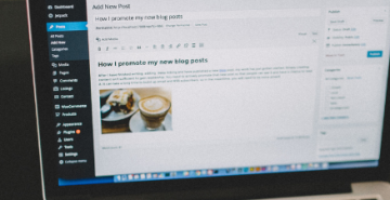Laptop screen with a blog being created for a business